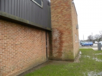 Overflowing gutter causes damp wall